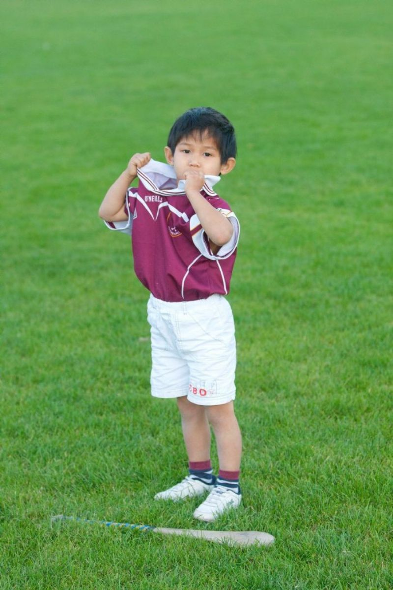 Young Ruairí Óg player Jack O'Reilly shows his support for his club.