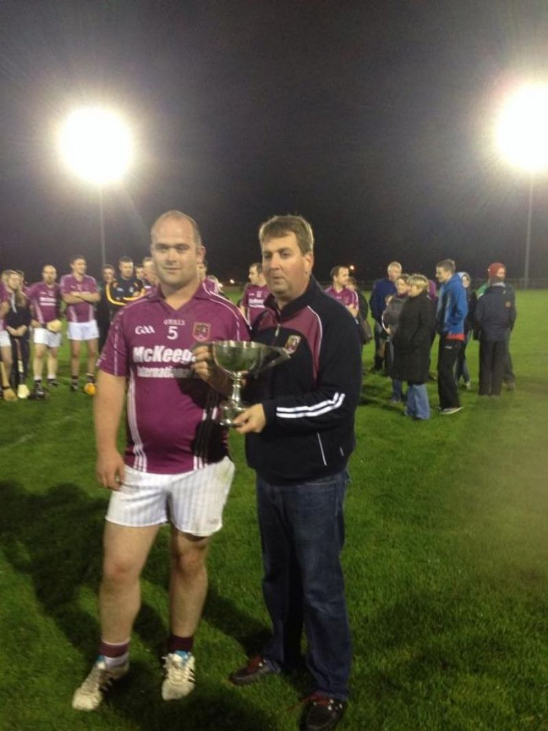 Captain Jamie Mooney collects the Junior Feis